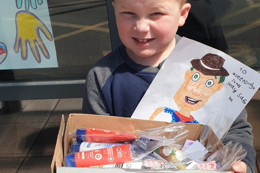 Olly with his pictures and hand cream